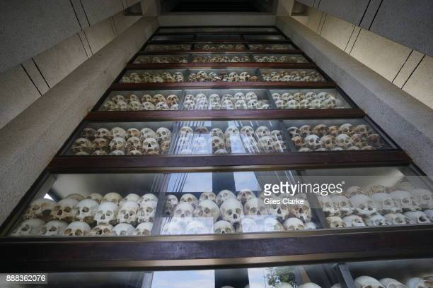 Human remains lie entombed and in the open air at Choeung Ek the site of a former orchard and mass grave of victims of the Khmer Rouge on September...