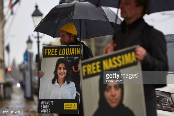 Human right activists demonstrate outside the Saudi Arabia embassy in The Hague for the release of all jailed women human rights activists in Saudi...