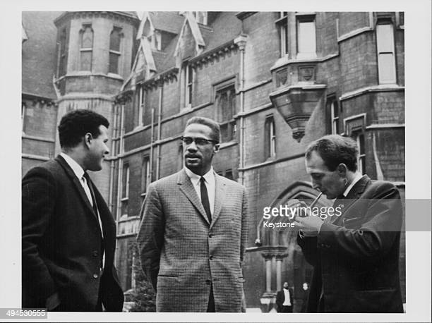 Human rights activist Malcolm X talking to two teachers during a visit, December 2nd 1964.