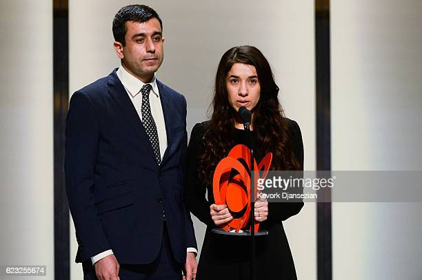 Human rights activist Nadia Murad right speaks onstage during Glamour Women Of The Year 2016 at NeueHouse Hollywood on November 14 2016 in Los...