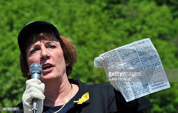 US human rights activist Suzanne Scholte shows an antiPyongyang leaflet before launching balloons carrying antiPyongyang leaflets across the border...