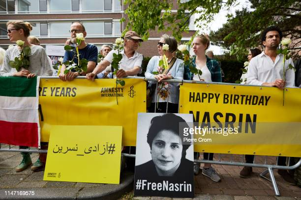 Human Rights activists attend the birthday party of jailed Iranian Human Rights lawyer Nasrin Sotoudeh outside the embassy of the Islamic Republic of...