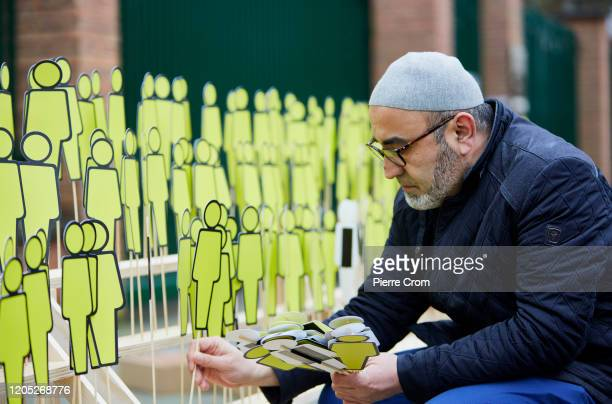 Human rights activists display dolls which they say depicts thousands of missing ethnic Chinese Uighur outside the Chinese embassy on March 5 2020 in...