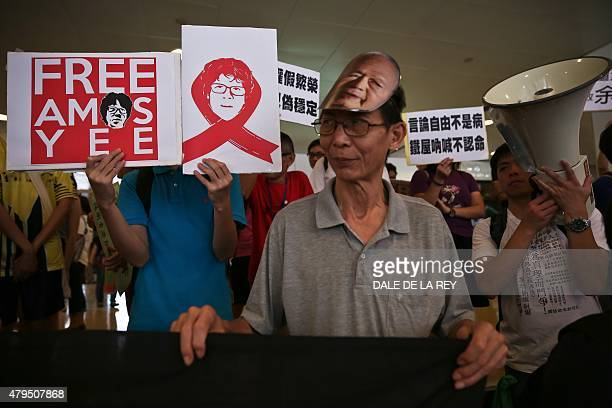 Human rights activists display placards showing support for 16yearold Singaporean Amos Yee during a protest in Hong Kong on July 5 2015 Yee was...