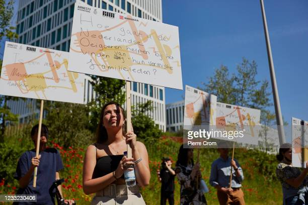 Human rights activists hold protest boards outside the Chinese embassy in The Hague on June 2, 2021 in The Hague, Netherlands. The activists ask for...