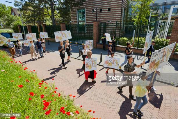 Human rights activists march to the Chinese embassy in The Hague to hand over a petition signed by 101 903 concerned Dutch residents on June 2, 2021...