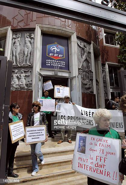 Human Rights activists protest infront of the French Football Federation headquarters on June 5 2012 in Paris to demand the release of the...