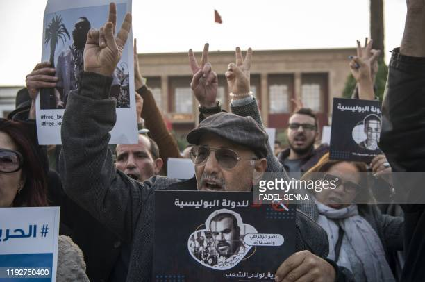 "Human rights activists shout slogans as they protest against a ""campaign of repression"" targeting posters on social networks and in support of..."