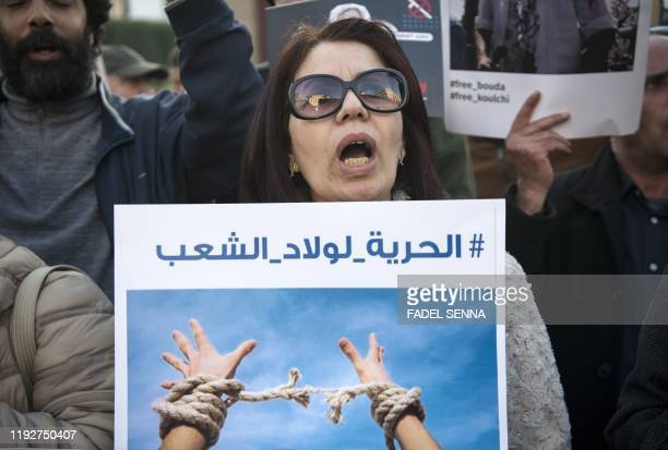 Human rights activists shout slogans as they protest against a campaign of repression targeting posters on social networks and in support of freedom...
