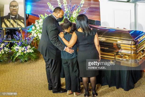TOPSHOT Human rights advocate Martin Luther King III and family show their respect to the remains of George Floyd awaiting a memorial service in his...