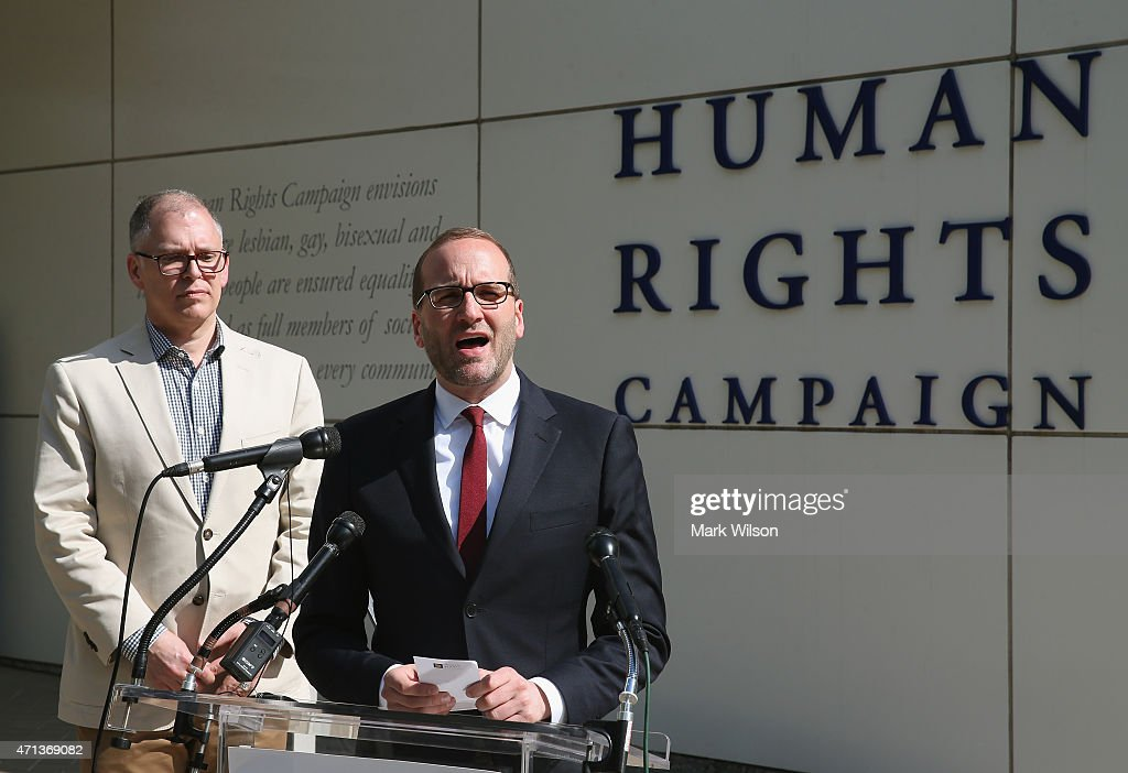 Human Rights Campaign President Chad Griffin (R) speaks about Plaintiff's James Obergefell (L) case before tomorrow's arguments at the US Supreme Court April 27, 2015 in Washington, DC. Tomorrow the high court is scheduled to hear arguments in the case of Obergefell v. Hodges, that will ultimately decide whether states will still be allowed to ban same sex marriage and refuse to recognize the rights of couples married in other states.