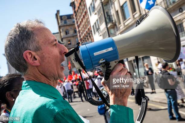 Human rights campaigner Peter Tatchell shouts into a megaphone during an LGBT rights protest outside Commonwealth House during the 'Commonwealth...