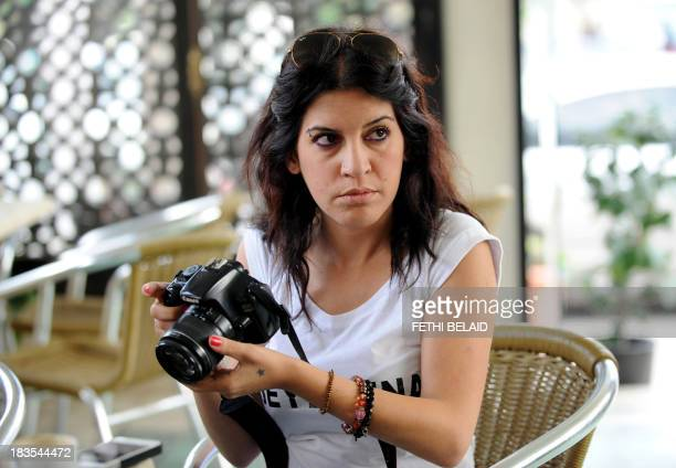 Human rights defender internetactivist and blogger Lina Ben Mhenni who was previosly nominated for the Nobel Peace prize takes photos outside the...