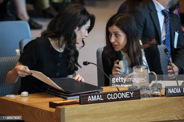 Human rights lawyer Amal Clooney and Iraqi human rights activist Nadia Murad Basee Taha attend a United Nations Security Council meeting at UN...