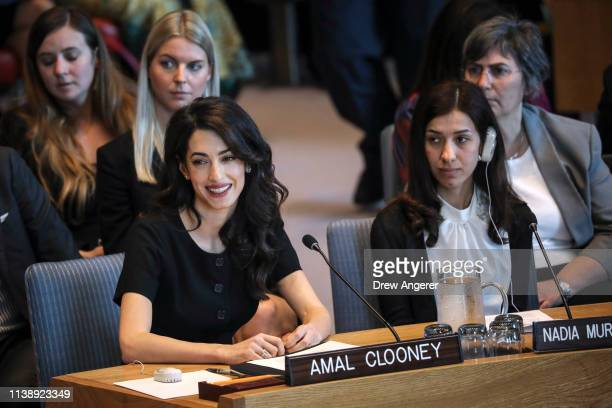 Human rights lawyer Amal Clooney as Iraqi human rights activist Nadia Murad Basee Taha looks on during a United Nations Security Council meeting at...