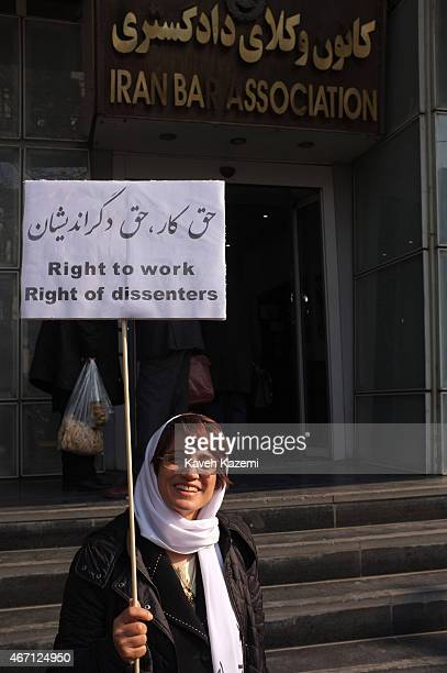 Human rights lawyer Nasrin Sotoudeh photographed while holding a banner demanding her rights to work outside the bar association during her daily...