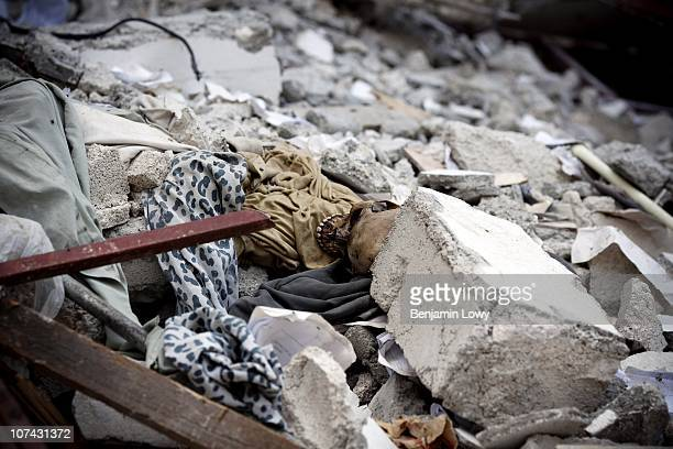 Human skull lies unclaimed, the remains of an earthquake victim, in the collapsed St. Gerard Technical College in Carrefour Feuilles, Port au Prince...