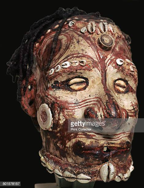 Human skull used for ancestor worship with features modelled in clay and painted from the Sepik river in New Guinea Now in the Royal Scottish Museum...