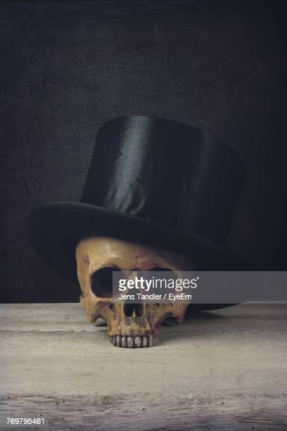Human Skull With Hat On Table