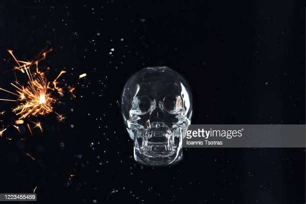 human skull with sparks over black background - brain  stock pictures, royalty-free photos & images