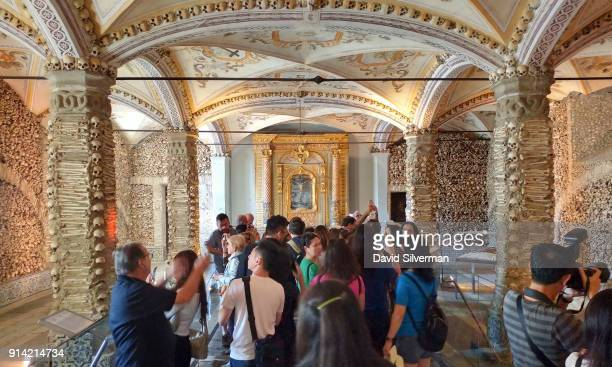 Human skulls and bones cover the interior walls of the Capela dos Ossos on September 30 2016 in Evora Portugal The Capela dos Ossos was built in the...