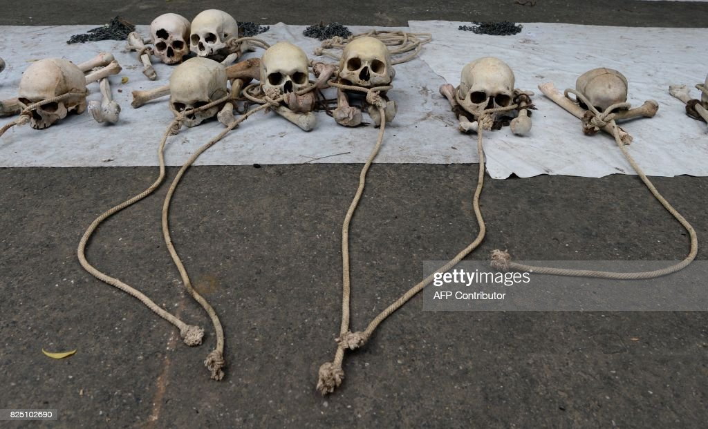 Human skulls, which farmers from Tamil Nadu state said belong to farmers who had committed suicide, are laid out during a protest in New Delhi on August 1, 2017. Farmers from Tamil Nadu are protesting in New Delhi with the bones of farmers who have committed suicide in the wake of a prolonged drought and rising amounts of debt, seeking action from the government including the write-off of bank loans and relief packages for drought affected areas. /