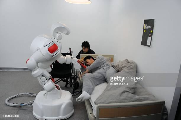 Human Symbiotic Robots In Tokyo Japan On November 27 2007 The development of human symbiotic robots that can support human daily activities is...