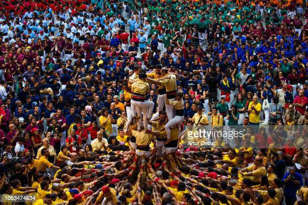human tower built during the castellers competition in tarragona. - castellers stock photos and pictures