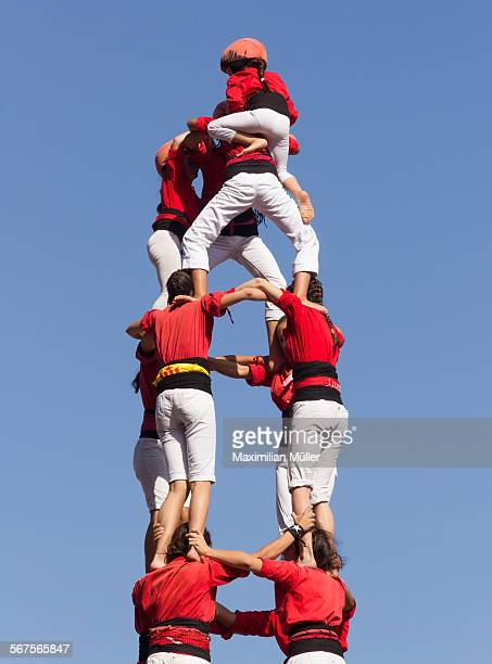 human tower close-up, barcelona - pyramid stock pictures, royalty-free photos & images