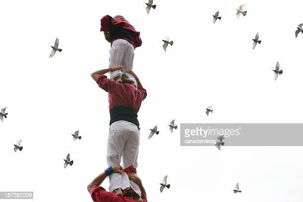 human tower & doves - pyramid stock pictures, royalty-free photos & images