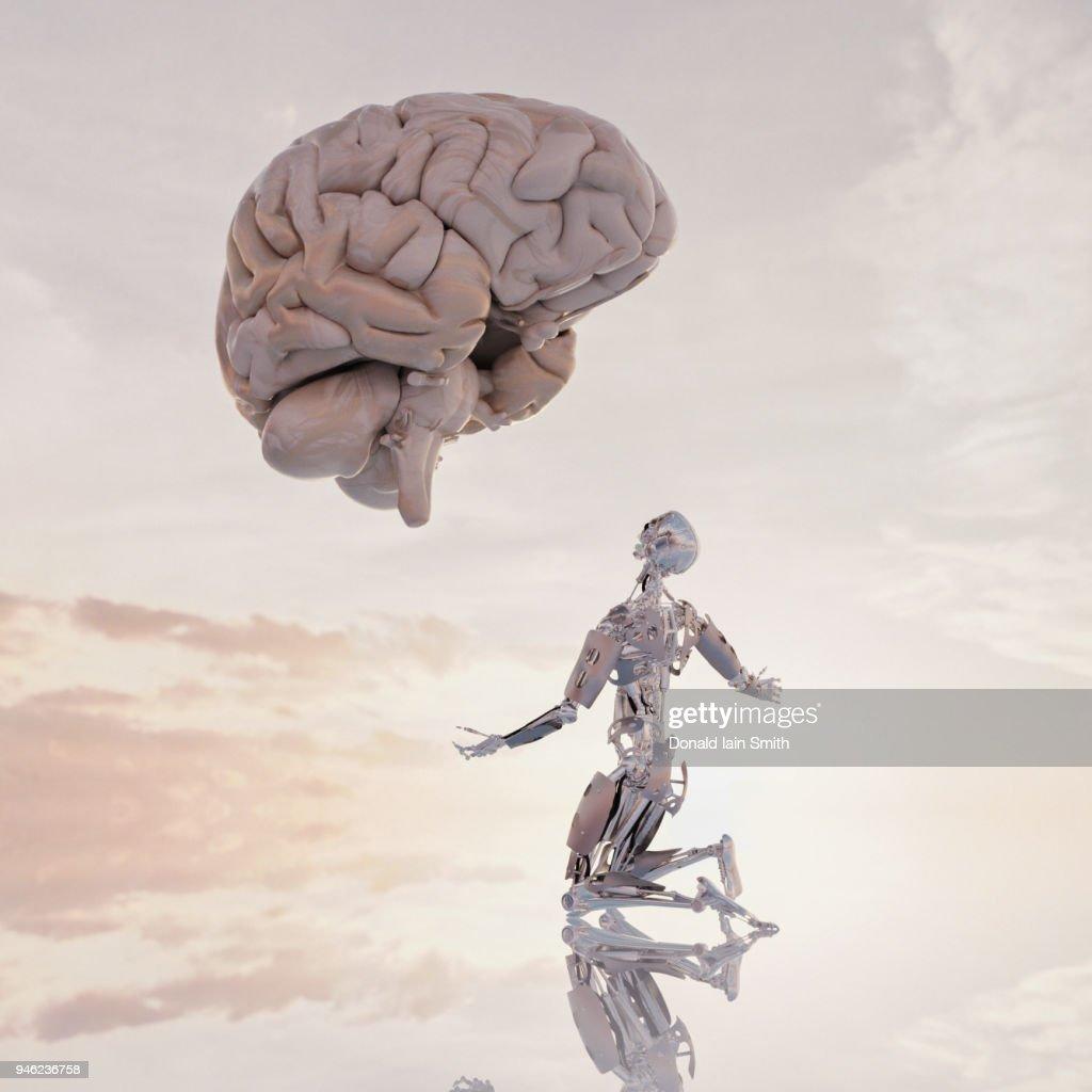 Human versus machine: robot supplicates before giant floating human brain : Foto de stock