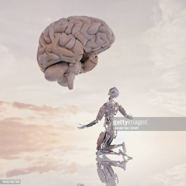 Human versus machine: robot supplicates before giant floating human brain
