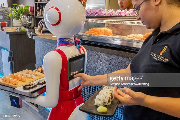 Human waiter types the table number on the terminal where the robot waiter will go to bring the food on July 25 2019 in Rapallo Italy The Gran Caffè...