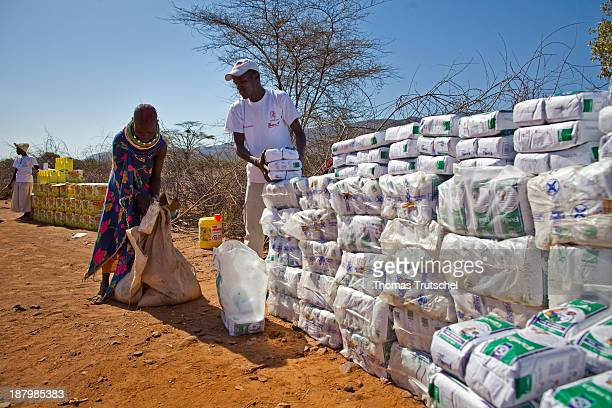 Humanitarian aid by the German aid organization Johanniter Unfallhilfe in North Kenya helpers are distributing food here flour to natives