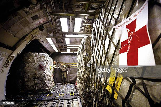 Humanitarian aid from the Dutch Red Cross is being loaded into an airplane of the Dutch airforce at Eindhoven early 30 December 2003 The goods...