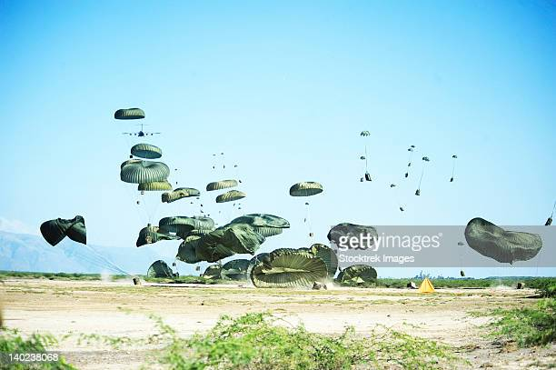 humanitarian aid is airdopped into the outskirts of port-au-prince, haiti. - humanitarian aid stock pictures, royalty-free photos & images