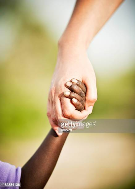 humanitarian aid: lending a hand to africa - humanitarian aid stock pictures, royalty-free photos & images