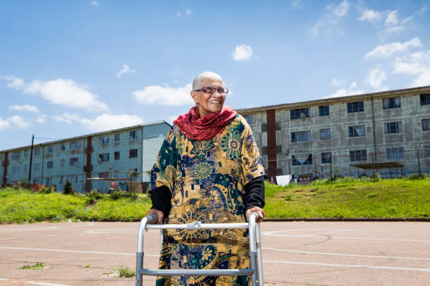 A Humanitarian and social activist, poses for a portrait near home in Austerville, Durban.