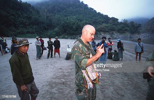 Humanitarian commandos Karen State American Dentist Shannon Allison checking a 45mm gun he borrowed for his own security
