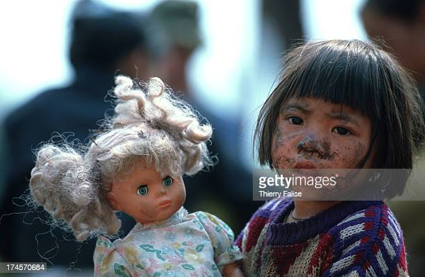 Humanitarian commandos, Shan States - A Shan girl with a present she got from a rare Western visitor in her camp..