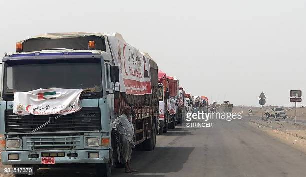 A humanitarian convoy of the UAE Red Crescent arrives in the Yemeni Red Sea port of Mokha on June 22 2018 Clashes between Yemeni government forces...