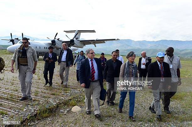 Humanitarian coordinator, Mark Bowden arrive at the airport to visit the landslide-affected area in Badakhshan province on May 5, 2014. Afghan...