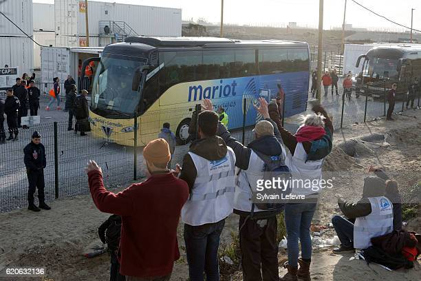 Humanitarian members waves to the bus during the unaccompanied migrants minor evacuation from the demolished 'Jungle' migrant camp on November 2 2016...