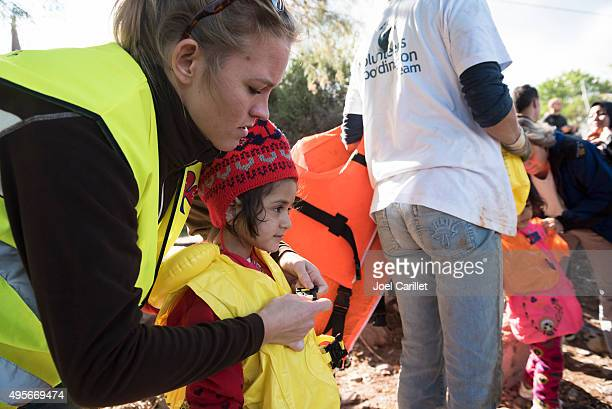 humanitarian volunteer assisting migrants traveling to europe - humanitarian aid stock pictures, royalty-free photos & images