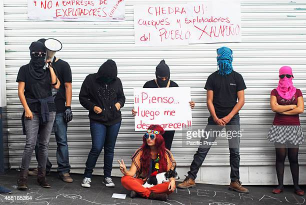 Humanities students close a supermarket in the center of Xalapa during their protest to return the Rural Normal School Raul Isidro Burgos.