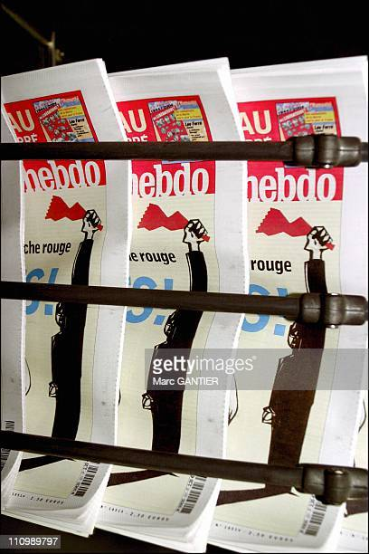 Humanity Hebdo falls off the press at the CIPP printing mill in Saint Denis in Saint Denis France on February 20 2004