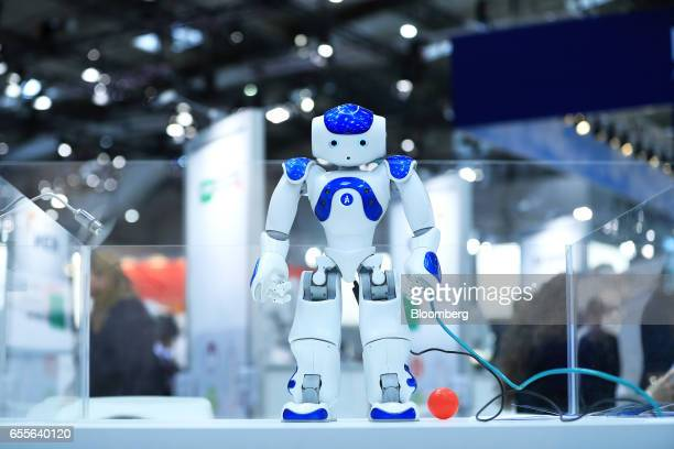A NAO humanoid robot developed by Softbank Corp stands on display at the CeBIT 2017 tech fair in Hannover Germany on Monday March 20 2017 Leading...