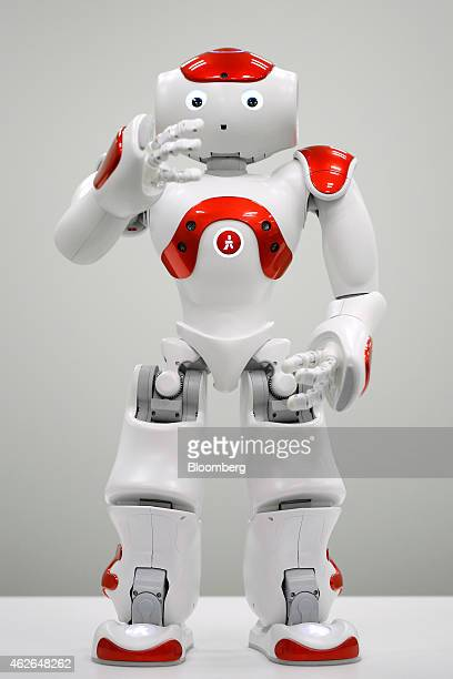 A NAO humanoid robot developed by Softbank Corp subsidiary Aldebaran Robotics SA performs as a lobby attendant during a demonstration in Tokyo Japan...