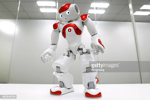 A NAO humanoid robot developed by Softbank Corp subsidiary Aldebaran Robotics SA performs during a demonstration in Tokyo Japan on Wednesday Jan 28...