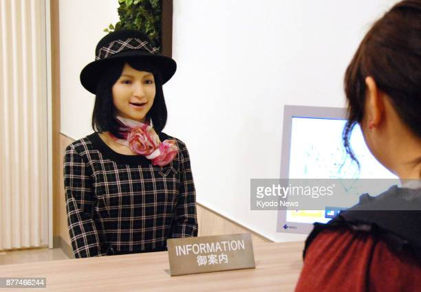 A humanoid robot equipped with a system allowing it to have advanced conversations using AI talks to a customer at Primetree Akaike shopping mall in...